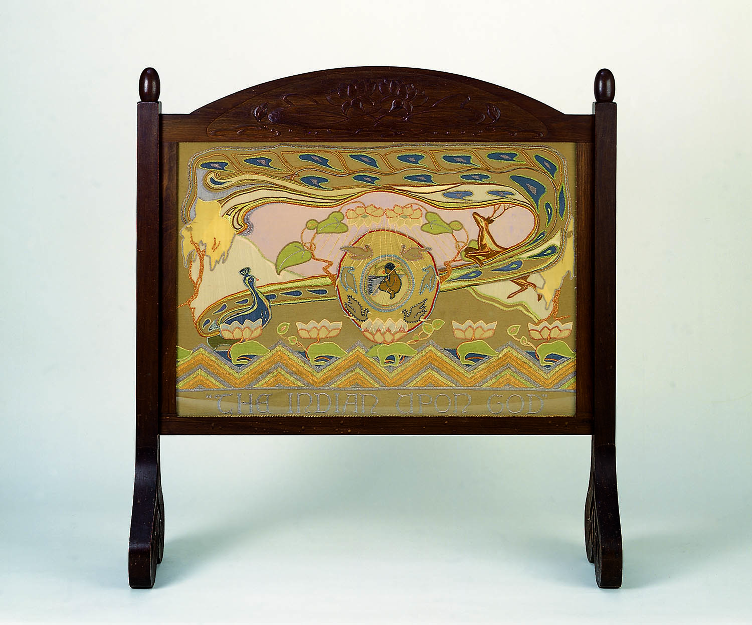 Mary P. Harris, designer/embroiderer,Australia, 1891 ‑ 1978 and Edwin Newsham, Australia, 1891 ‑ 1989, The Indian upon God fire screen, 1929, Adelaide,silk & wool embroidery on linen, carved manchurian oak frame,120x110x30.5cm.South Australian Government Grant 1980,Art Gallery of South Australia, Adelaide.8011A213A