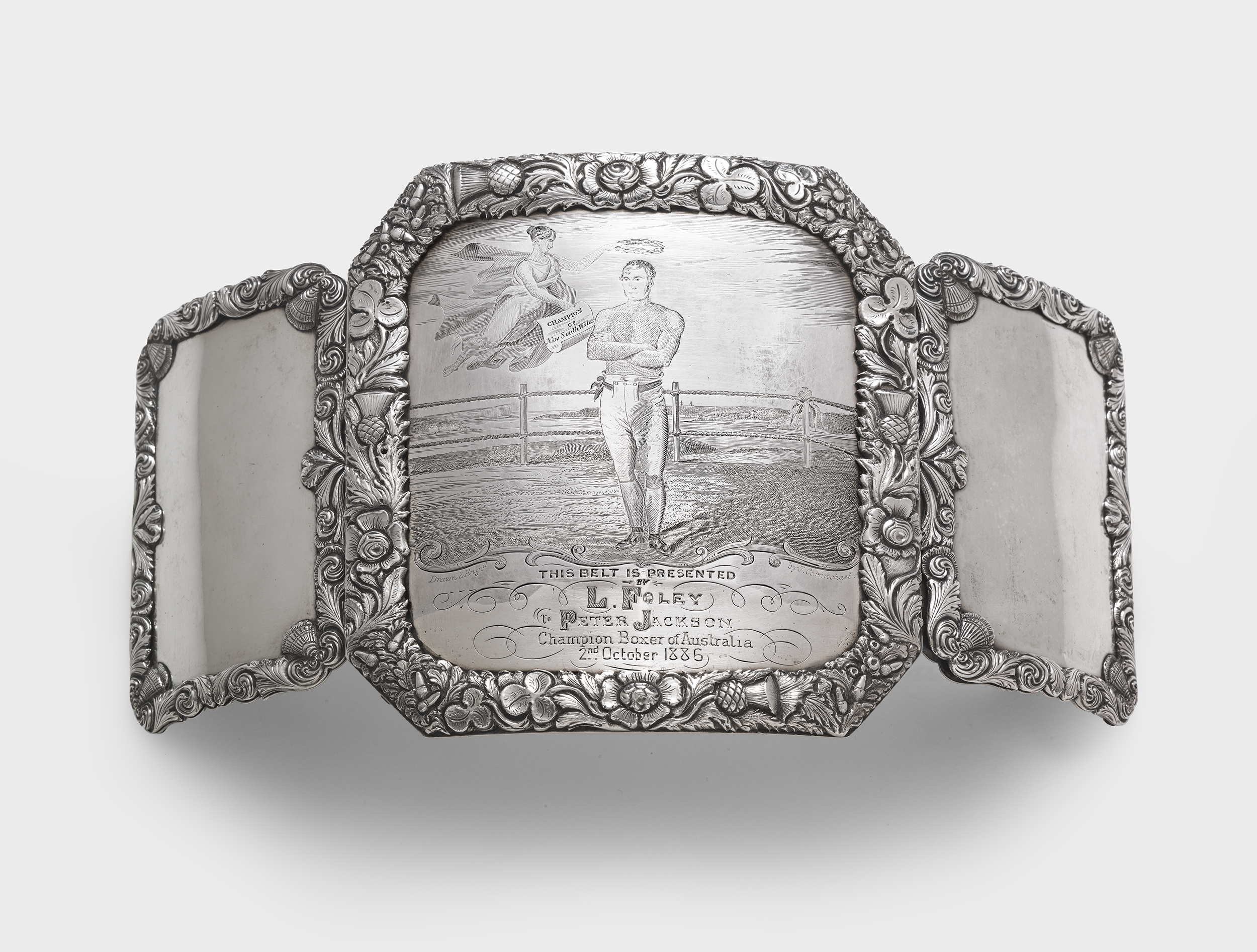 John Cohen  (silversmith) and  John Carmichael  (engraver). Presentation champion's boxing belt buckle 1839-1847 sterling silver: fabricated, stamped, repousséed, chased, engraved. National Gallery of Australia, Canberra. Purchased 2014
