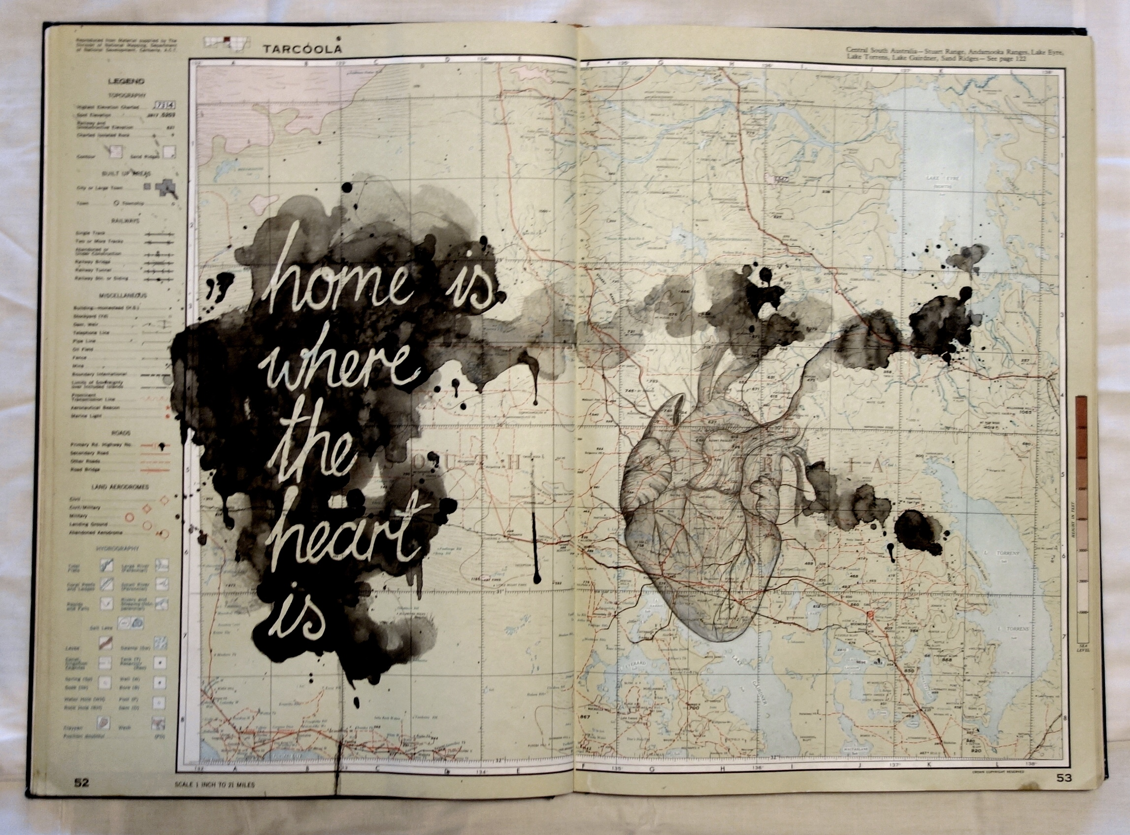 Gabi Lane,  Home is where the heart is , 2017, watercolour and ink on recycled Australian Atlas, 55x40cm