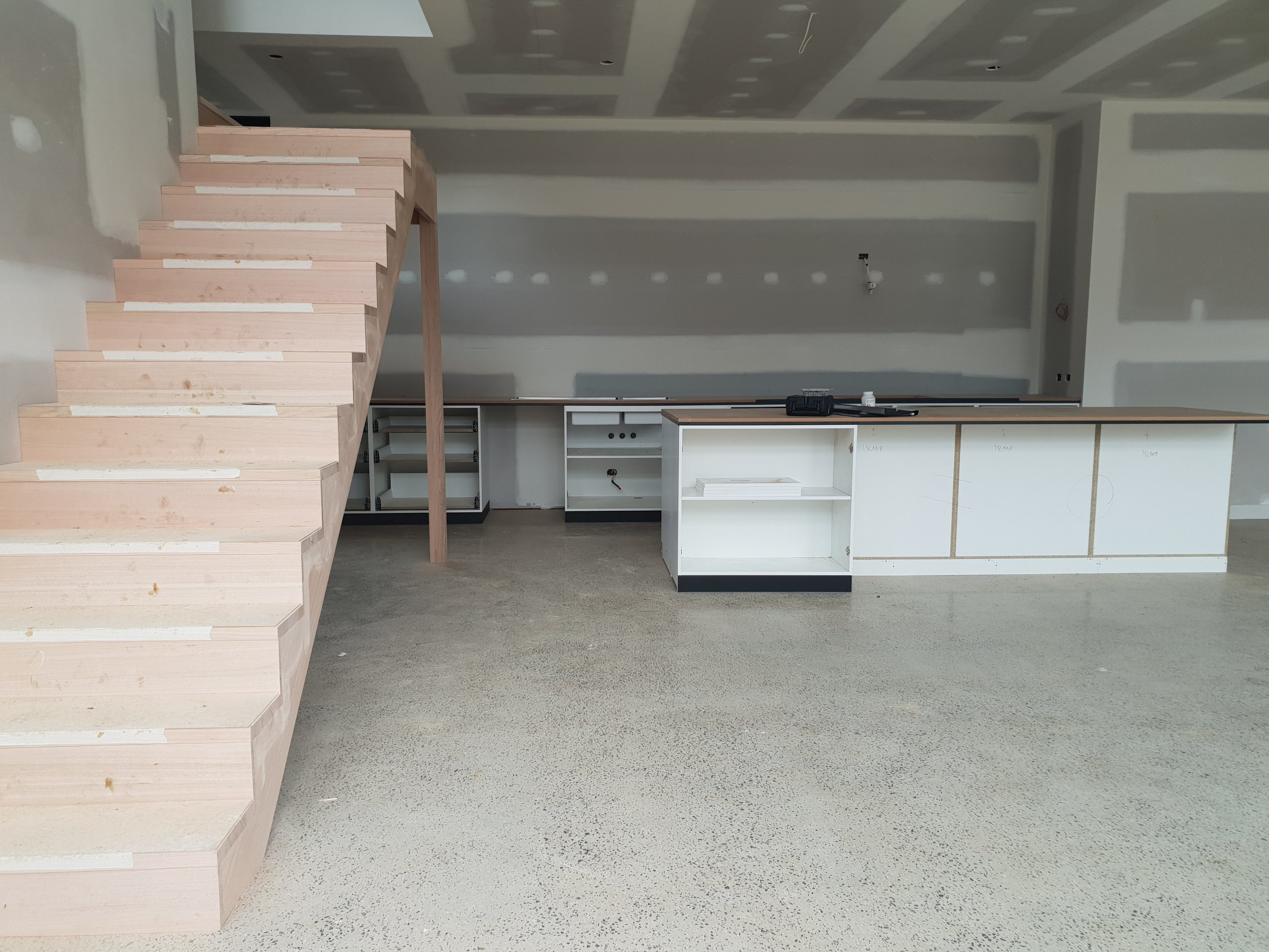 lifespaces bluestone house kitchen stairs.jpg