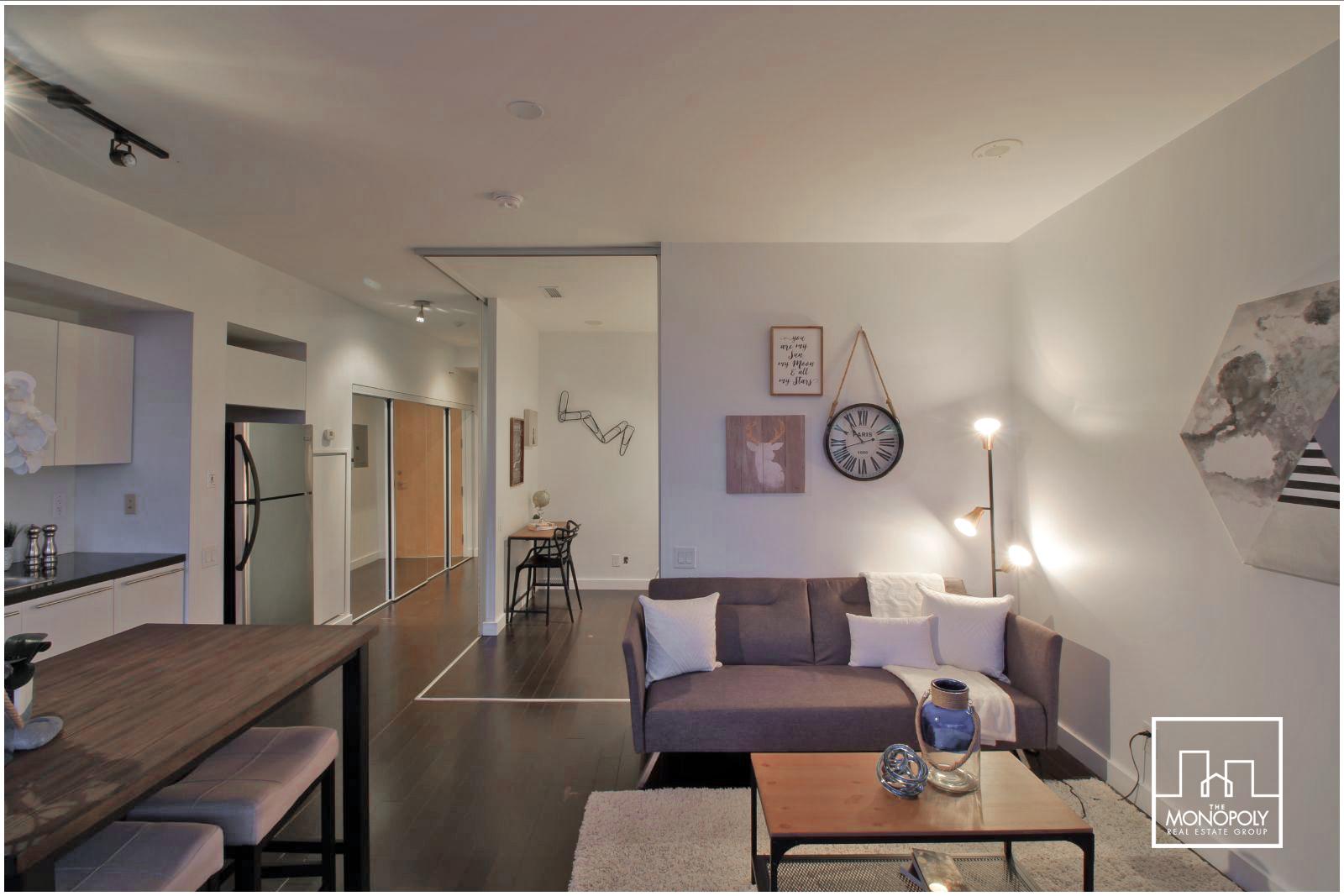 01 - Living 3 Room Straight Shot.jpg
