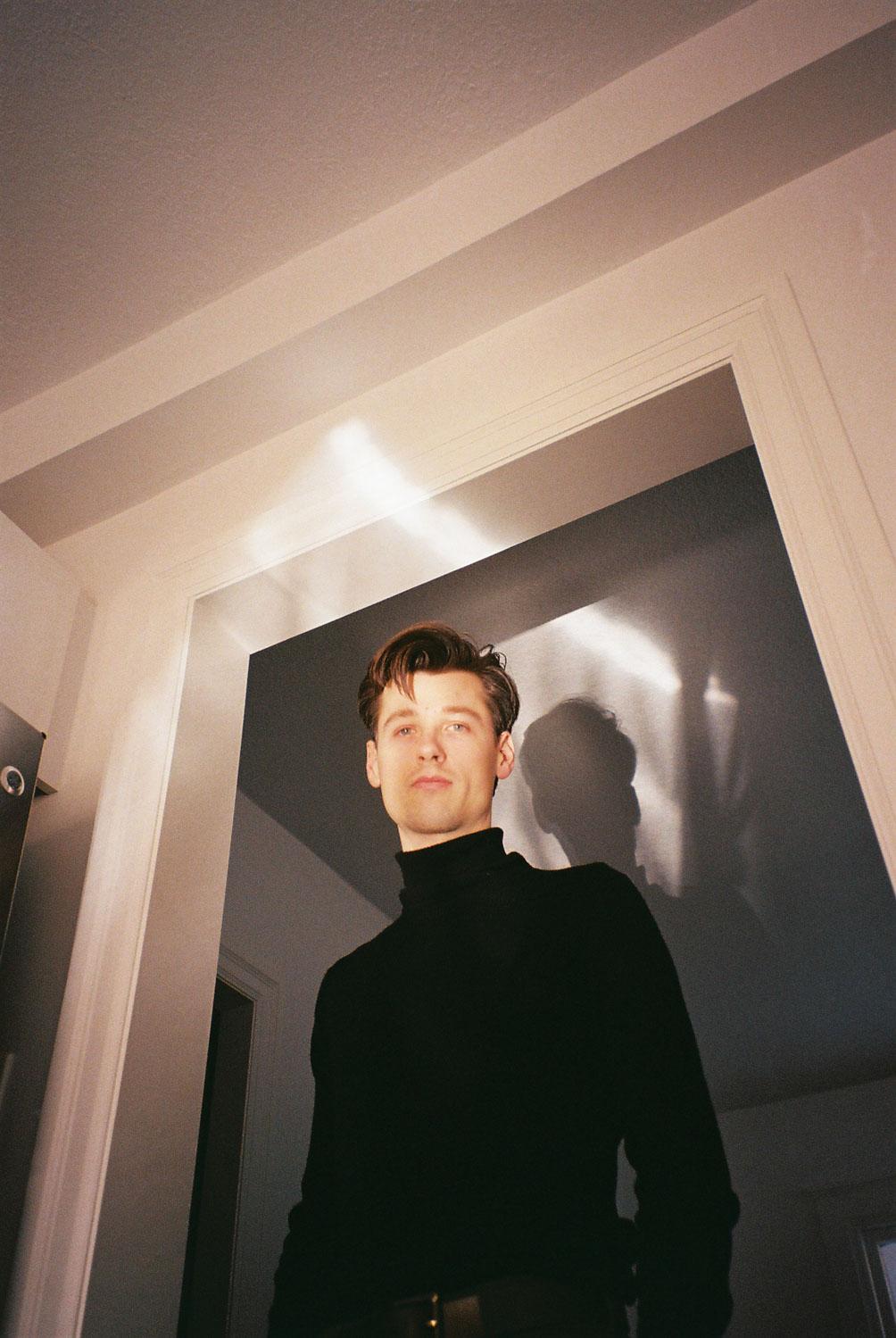 boy standing in reflected light-2.jpg
