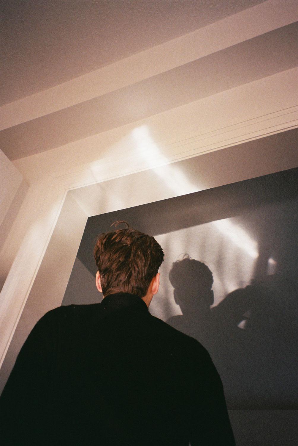 boy standing in reflected light-4.jpg
