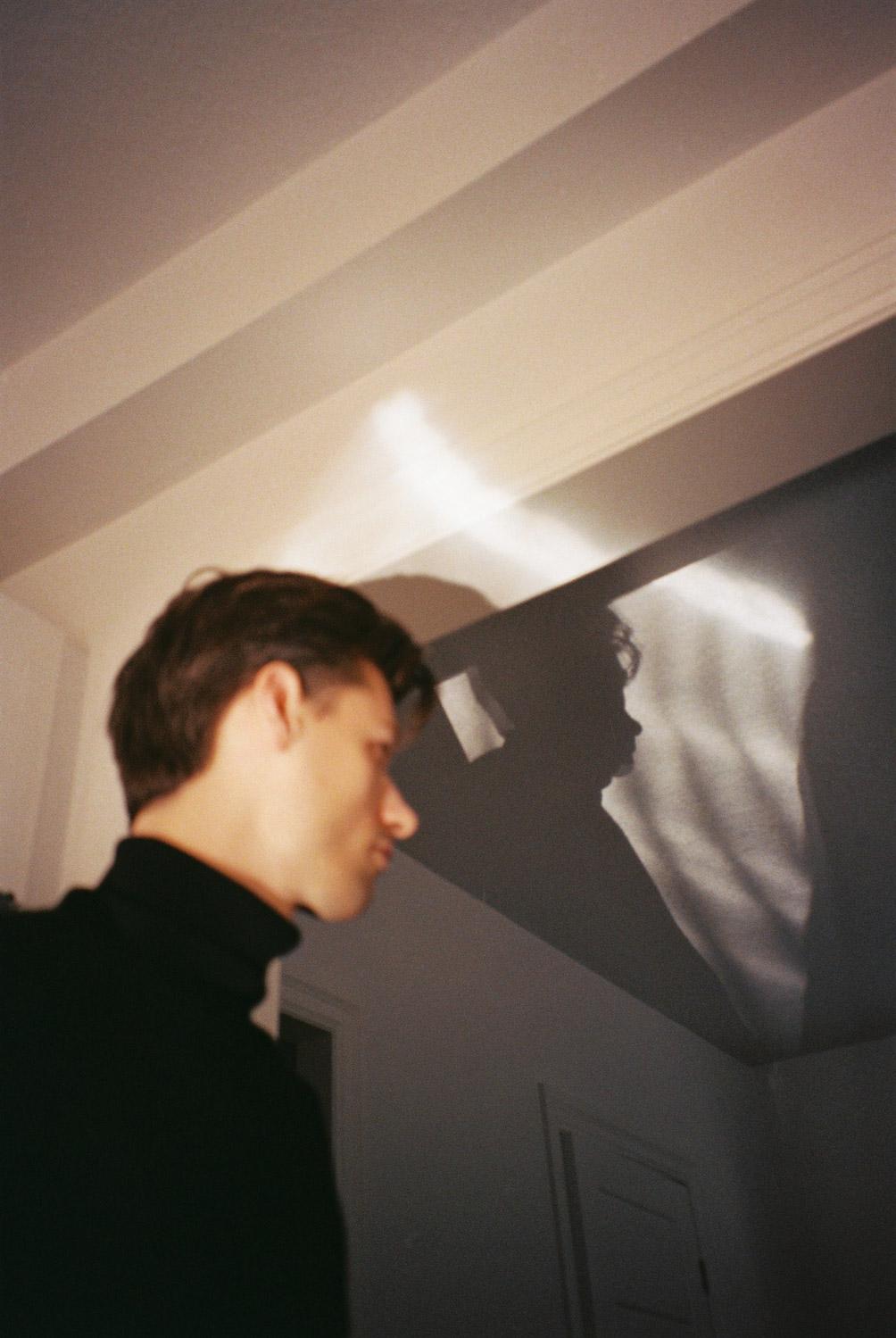 boy standing in reflected light.jpg