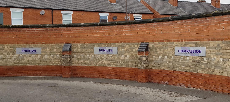 Brushed aluminium wall signs