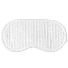 Your blackout curtains aren't going to fit in the case. Make like Holly Golightly and take matters into your own hands with this super soft white waffle  eye mask .