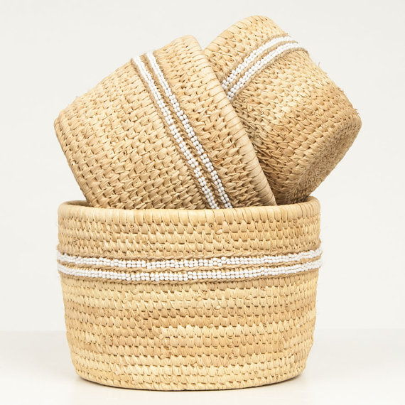 B  askets densely woven with beads made by Kenyan Ngurunit weavers.