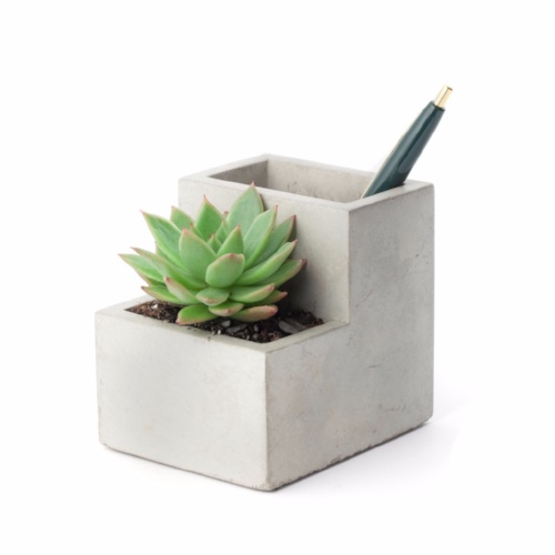 Bring the outdoors in // - As true at work as it is at home, plants give a feeling of life and energy. Add a practical desktop holder. This multi-tasking planter is 100% clinically proven to improve the most overworked of moods.Plant holder and desk organiser,Trouva - £19.50