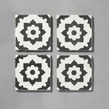 There's a strong Spanish influence to Bert & May's glazed, black and white  Santona  tiles.