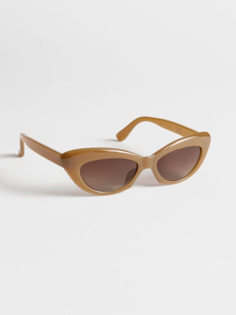 Tiny sunglasses aren't going away and neither is this glossy caramel shade from   & Other Stories