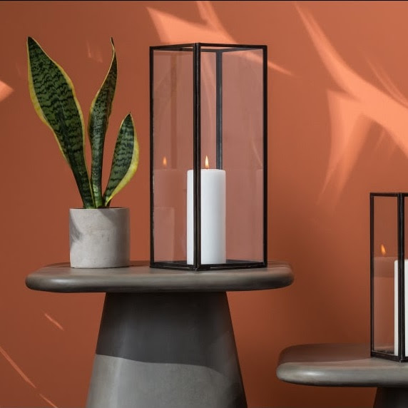 This   glass lantern   from Made calls itself a candle frame. And why shouldn't it?