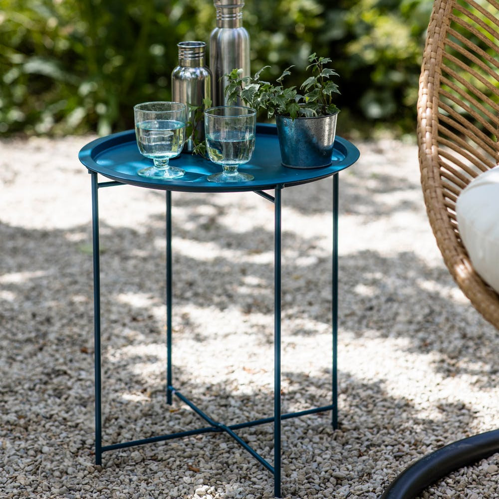This   bistro table   is practical, the tray can be removed and slots into solid legs. And it adds a pop of colour
