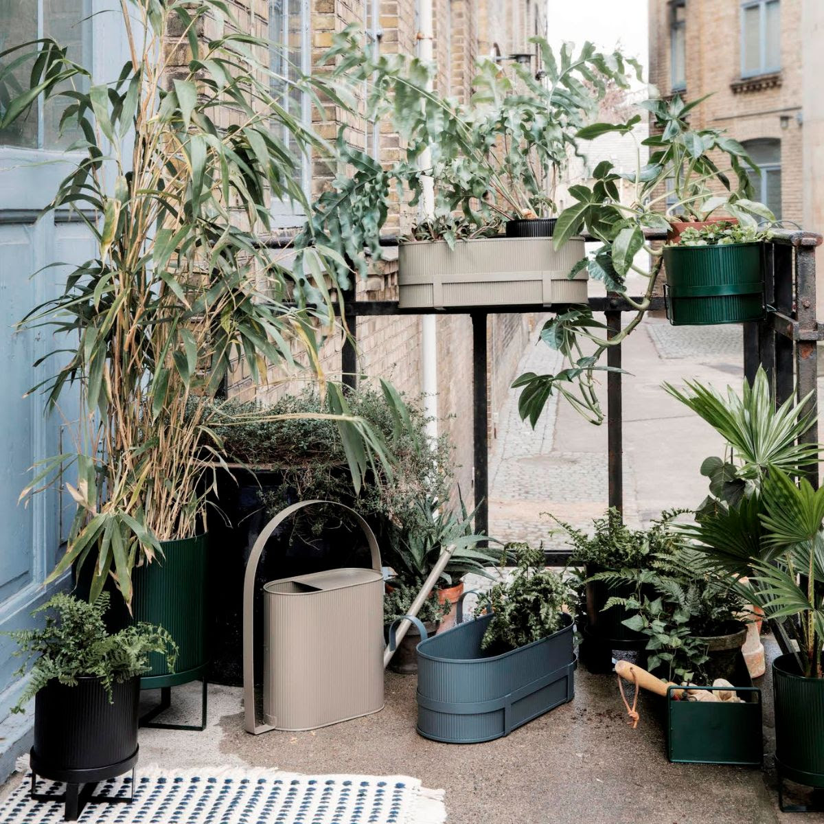 Use Ferm Living planters, like this one from   Kin  , seasonally (basically don't leave them outside over winter)