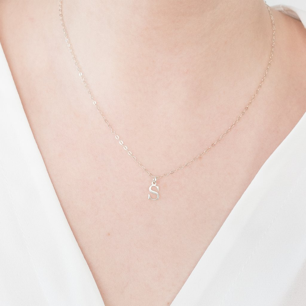 JQ's own Oh My Clumsy Heart's whole  thing  is minimal jewellery at a fair price. Their   sterling silver letter necklace   is no different. Also available in 14k gold.