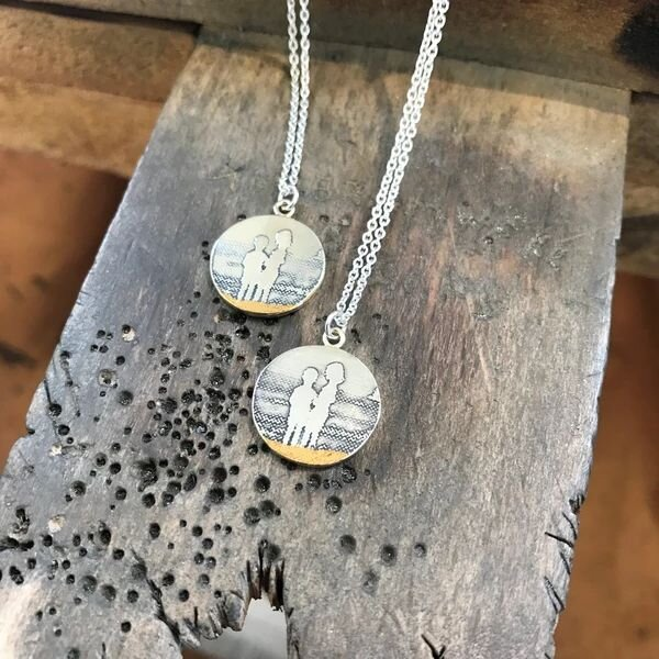 Super thoughtful gift idea incoming: Take a fave old photo and have the silhouette etched into a   memory necklace   by another JQ resident, Charlotte Lowe.