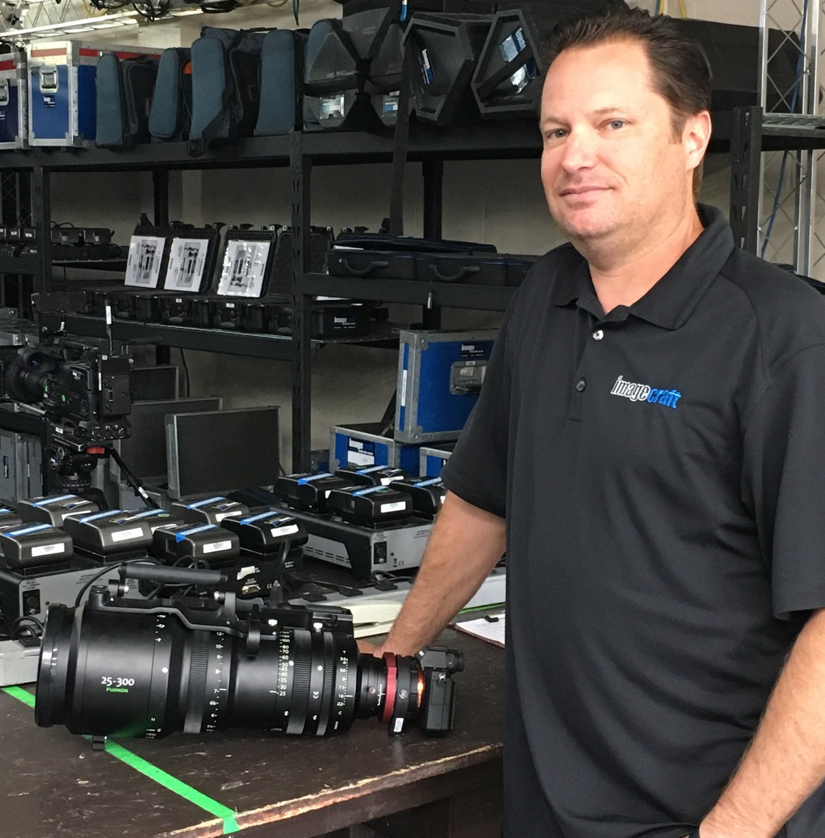 Jason Been, owner and operator of Imagecraft Productions, and the enormous Fujinon 25-300mm lens mounted to his Sony a7rII