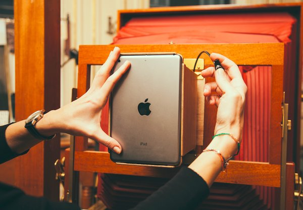 The iPad Mini is placed in a special custom made mount onto the Polaroid 20x24 camera and the exposure is made.