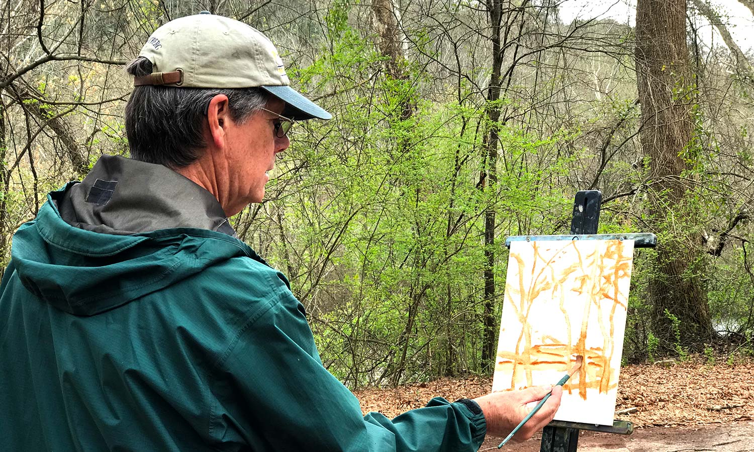 Artist Ralph Oberg begins a plein air painting during a workshop at Cooper's Furnace, near Catersville, Georgia.