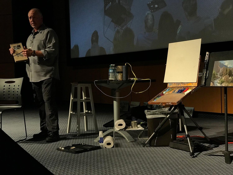 Scott Christensen shows his Kraft paper sketchbook during a demonstration at the Booth Western Art Museum in Cartersville, Georgia.