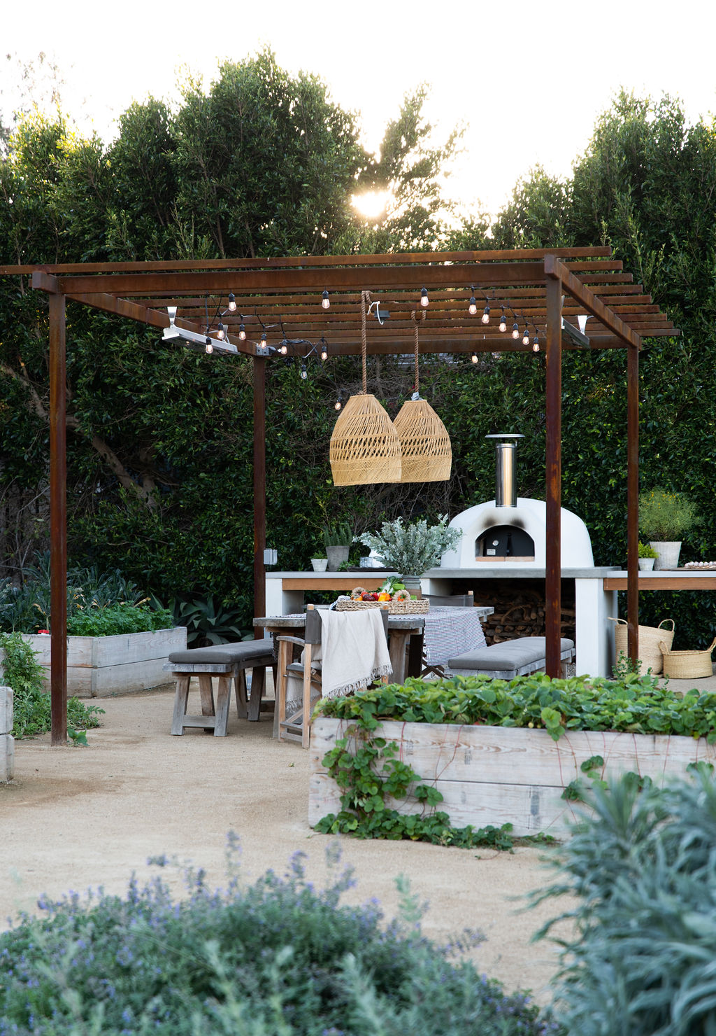 Malibu Modern Farmhouse by Burdge & Associates Architects in Malibu, California.  Outdoor Kitchen. #home #architecture #house #homeinspo #homedesign #outdoorkitchen #outdoordecor #outdoorfirepit #firepit #garden #gardening #veggiegarden