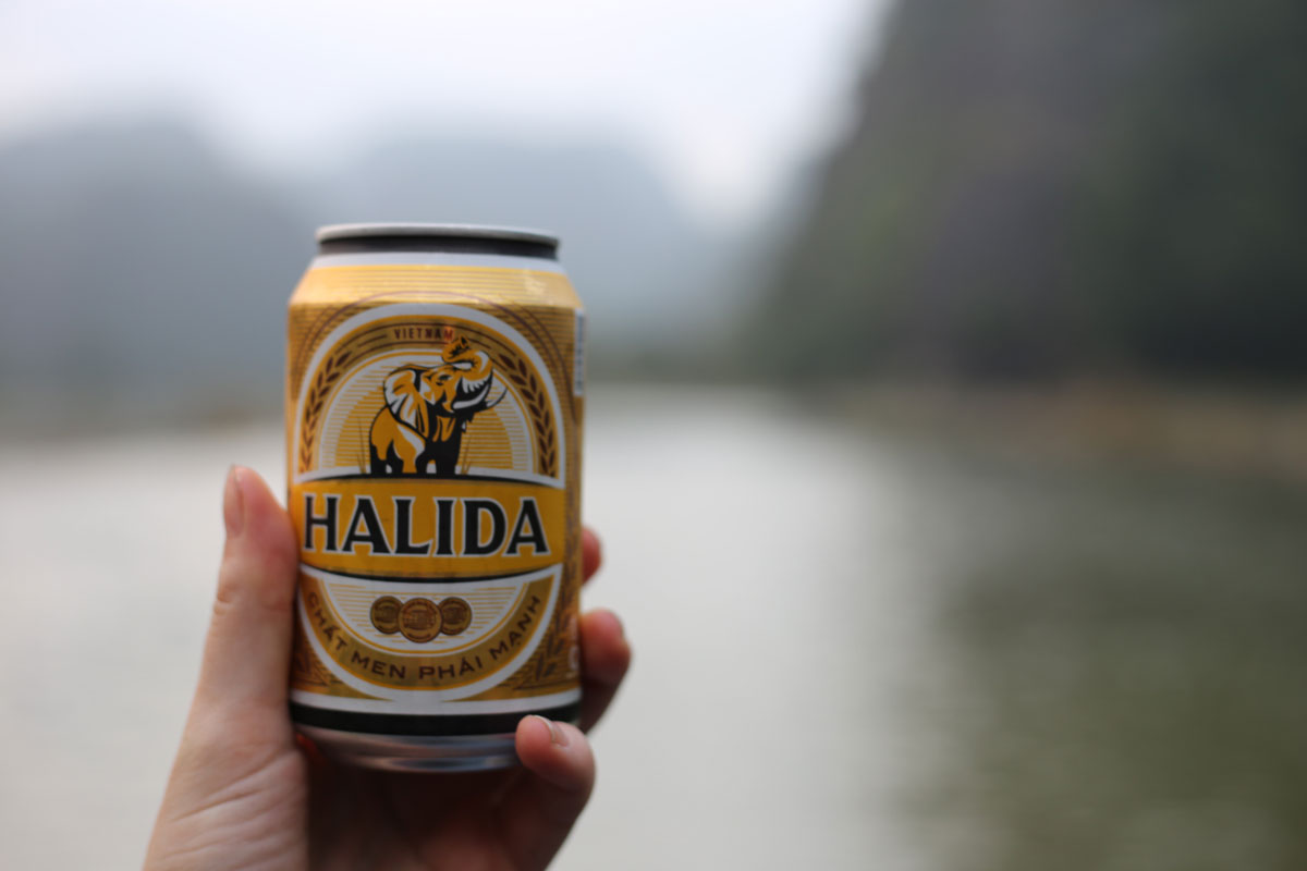 Romantic boat ride for two at Tam Cốc with my date Halida, a commercial beer available in Vietnam.