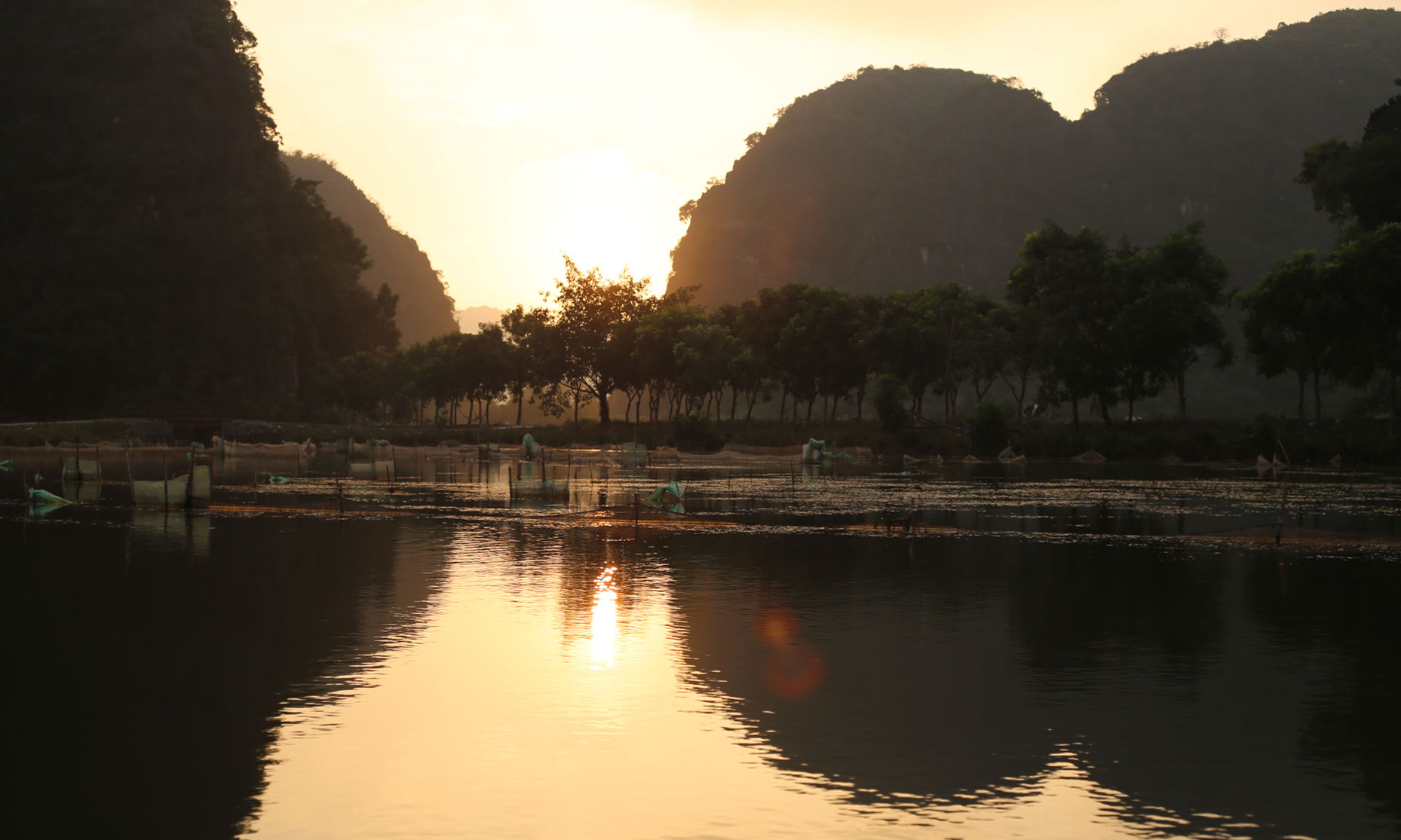 Sunset at Tam Coc, Vietnam. We took a romantic boat ride for three.