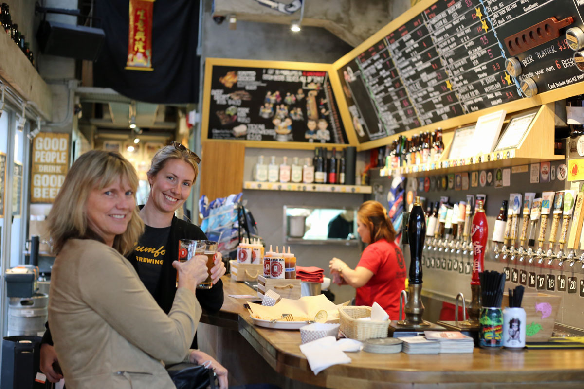 My mom flew in to hang out with me to help me recover from my injury. Since I couldn't walk, I had about a week where I was wheeled alternately between dumpling destinations and craft breweries. Here we are sipping brews at the Roundhouse, our favorite craft beer bar in Hong Kong.