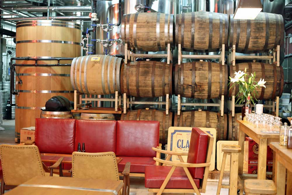 A tasting room separated from the brewery by a few barrels. Good vibes.