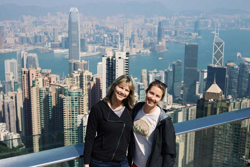 Mother and daughter on top of Hong Kong, matching head tilts and all.
