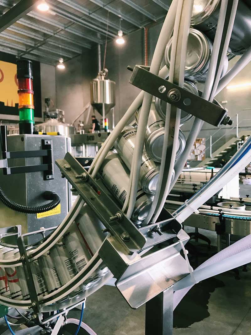 The Moo Brew canning line.