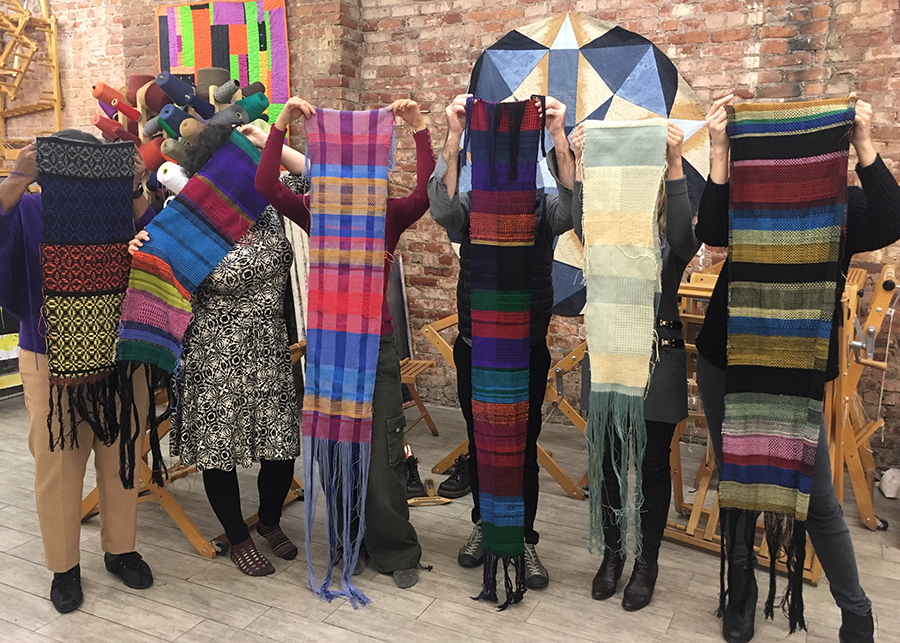 portrait of students with their woven work, Textile Arts Center, 2018
