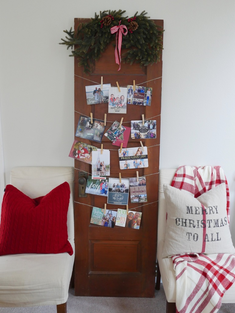 jen gilday interiors - use an old door to display christmas cards