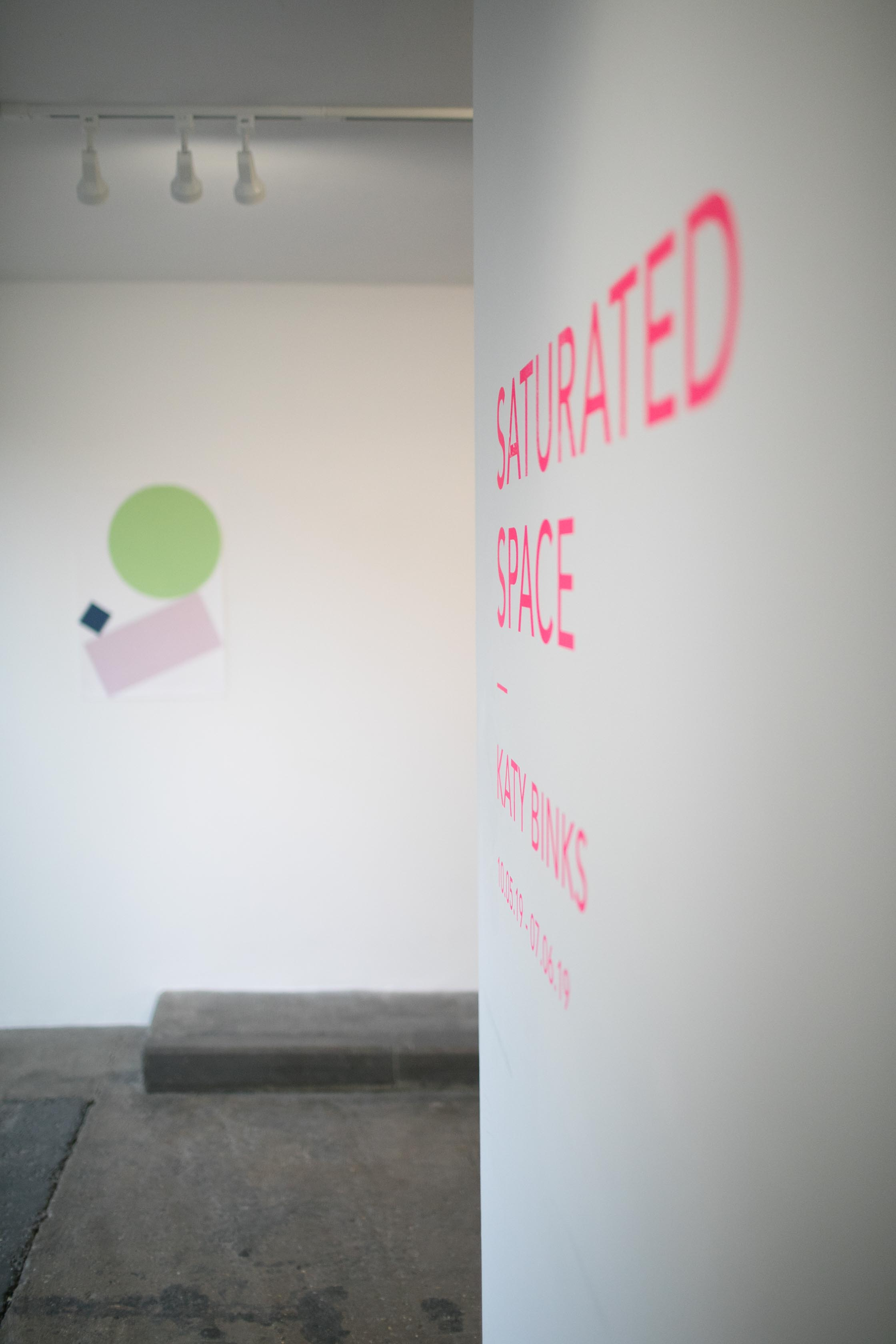 """Saturated Space - A dynamic installation of unique prints.ASC Gallery // 10.05.19 – 07.06.19PV 10.05.19 (6–9pm)In Saturated Space – her first UK solo show – Katy Binks presents a new collection of one-off, experimental screenprints in the form of a dynamic site specific intervention. Over the past year or so, Katy has been exploring a looser, more intuitive approach to printmaking. This new sense of freedom has invigorated her practice to such an extent that it now has more in common with painting than with edition-led printmaking.Saturated Space brings together a series of around fifty large abstract screenprints, which Katy has """"pasted on the walls billboard style… I wanted to create an installation that verges on overwhelming; quite in your face, but also with a stripped back graphic sensibility."""" The billboard mention hints at a background in graphic arts, with elements such as half-tone textures and hard graphic shapes referencing the visual landscape of commercial printing and outdoor advertising.The individual prints in the show are all unique, but there's an aesthetic thread linking them all. I might start with a stripe or a halftone dot image, but I'll try and keep things different by using paper stencils or monoprint techniques… As the number of prints grew I naturally started to place them together and look for links."""" It's an approach that embraces positive and negative space, placing equal importance on both the printed and unprinted surface. """"I'm always building images, using multiples or one-off prints so I can make something even larger. It's playful, placing things side by side to find a flow and rhythm from one image to the next."""" Her approach to colour is also intuitive. """"I have a colour palette that I can't escape, but in these works I've been actively looking for those high contrast moments that happen when vibrant colours are anchored by strong blacks and dark blues.""""Her new prints also explore her ongoing fascination with the relationship betw"""