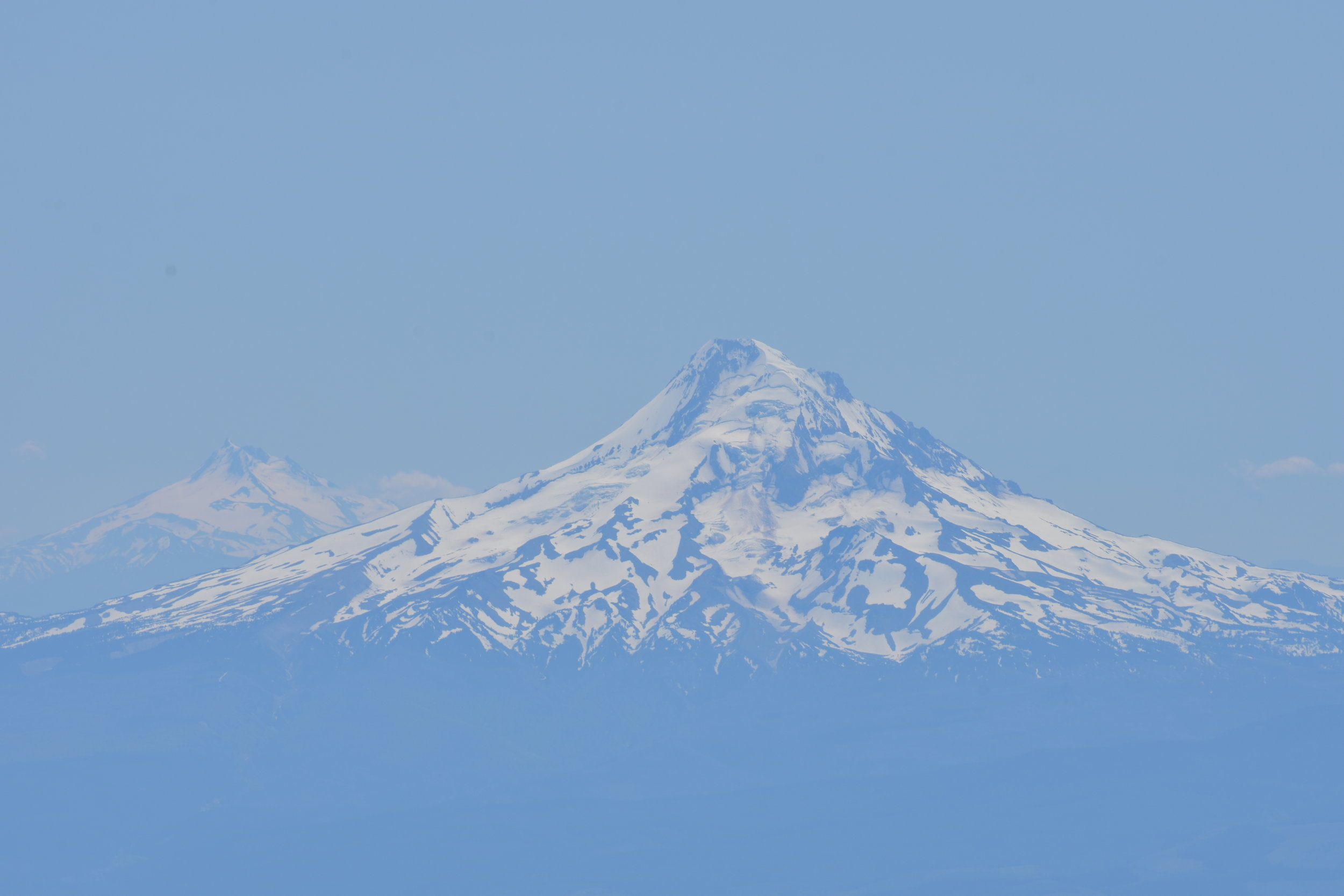 Mt. Hood in front of Three Sisters from Mt. Adams