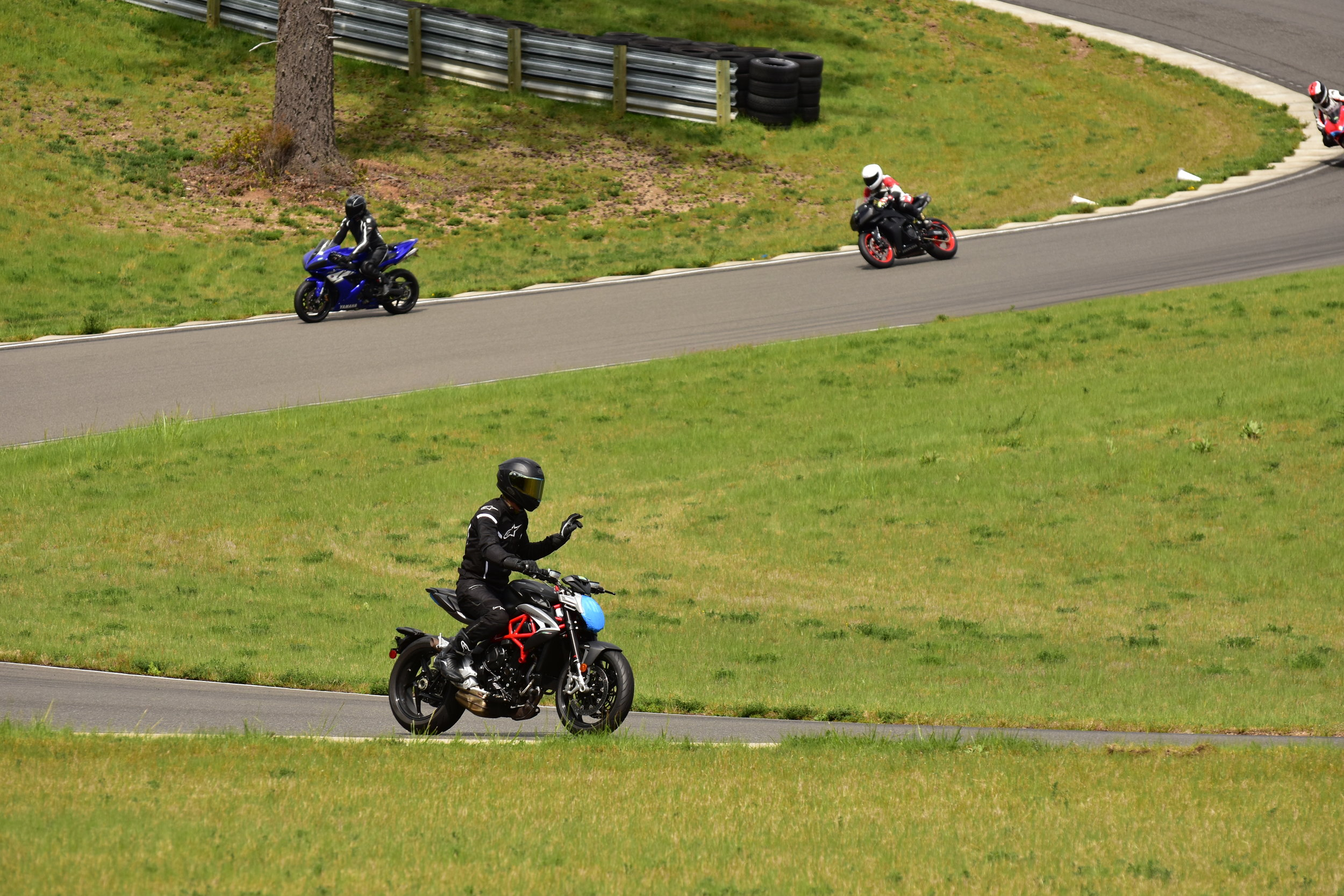 Calling it quits after standing up the bike to avoid hitting the downed Suzuki rider