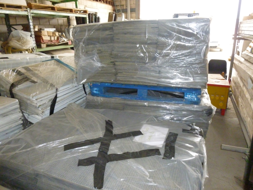 Glass partitions carefully packed for re-use in a new office