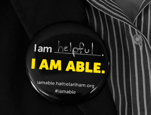 Wear your I Am Able button to show your support.