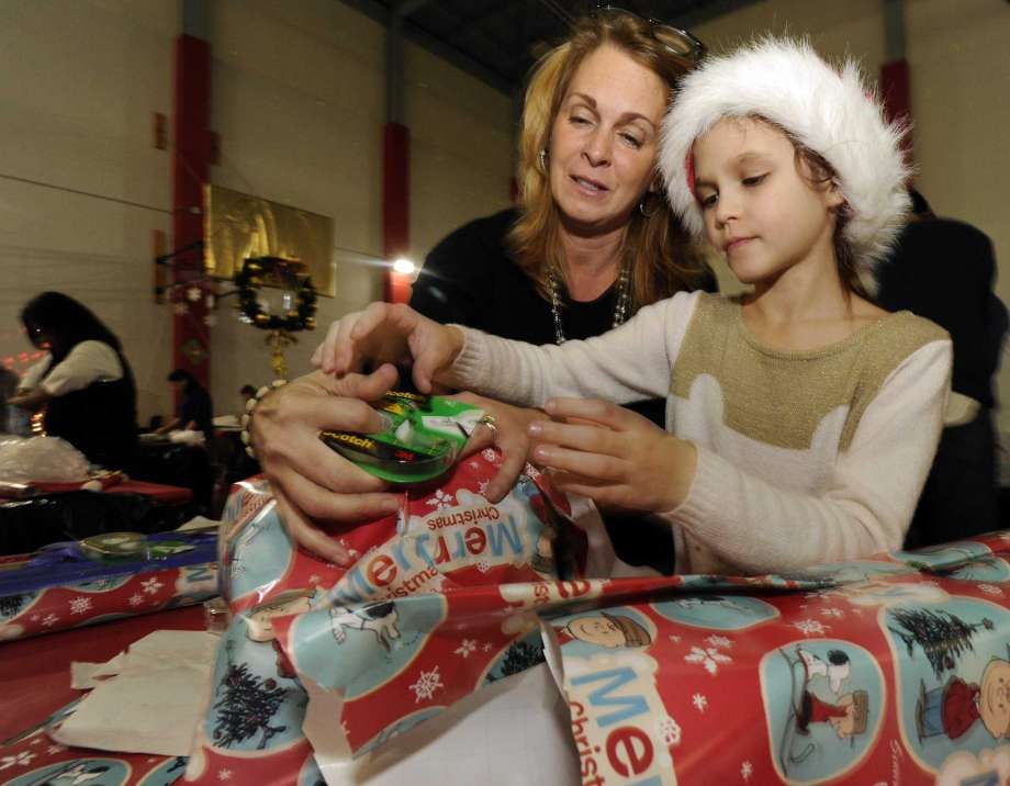 Volunteers Wrap Thousands of Gifts in Stamford for Children in Need     Dec. 2016 - Stamford Advocate