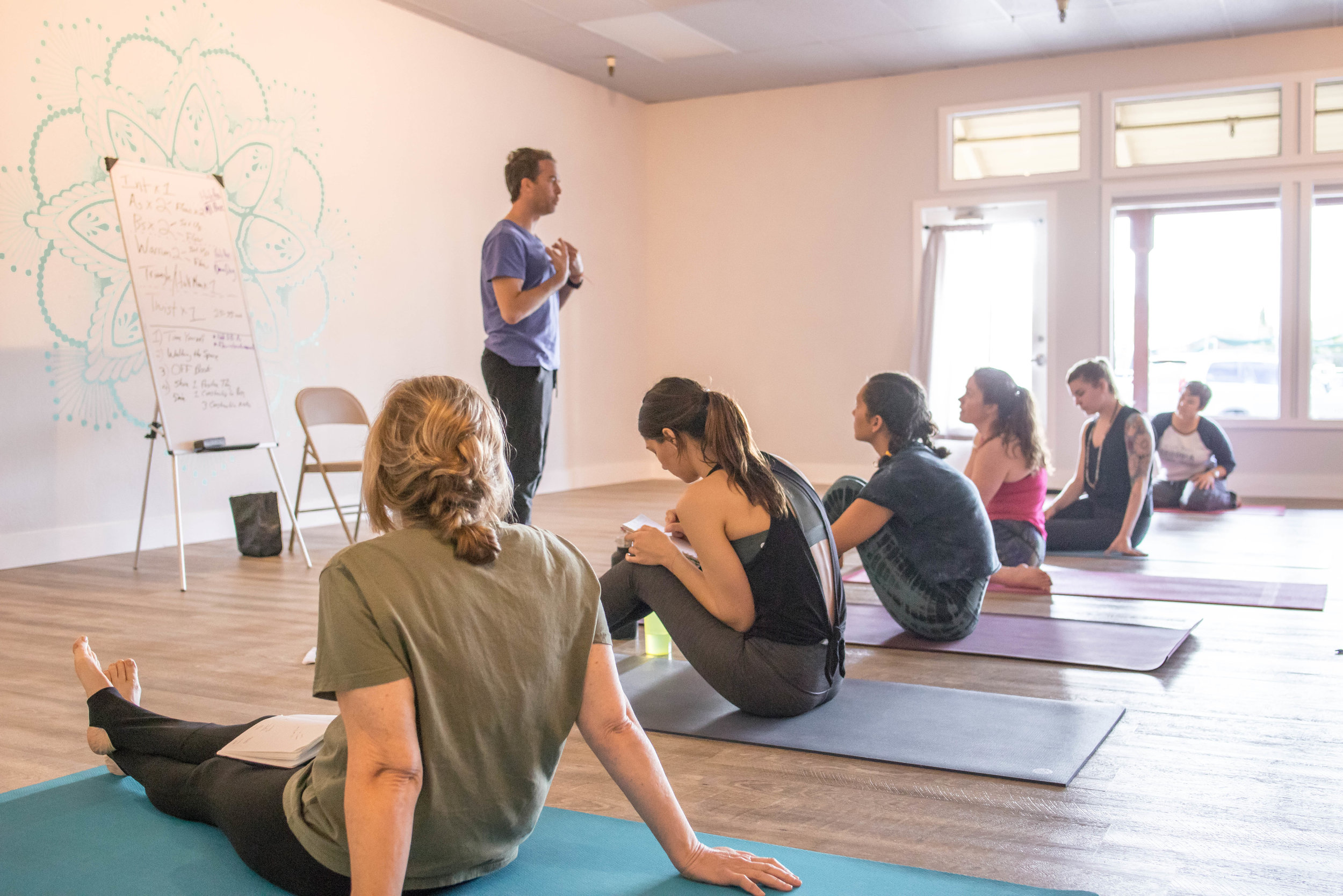 Travis Eliot lecturing at OTY's first 200hr Yoga Teacher Training