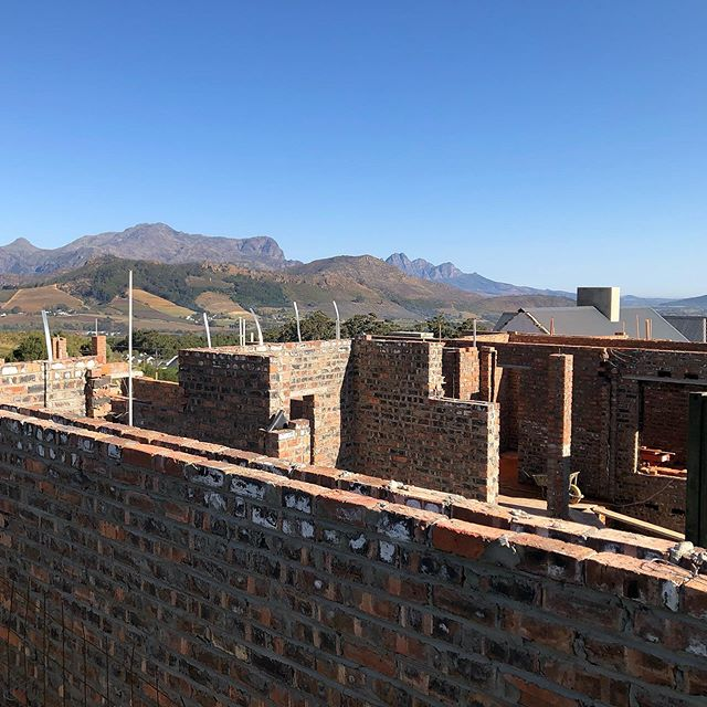 Happy Friday! Can you see the weekend in the background? . . . . . #franschhoek #capetown #views #siteview #dowhatyoulove #hometechnology #tech #architecture #interiorarchitecture #mountains #winelands #wintersun #southafrica #newbuild #designmatters #homeautomation #lightingautomation #smarthometechnology #capetownhomes #capetownluxury