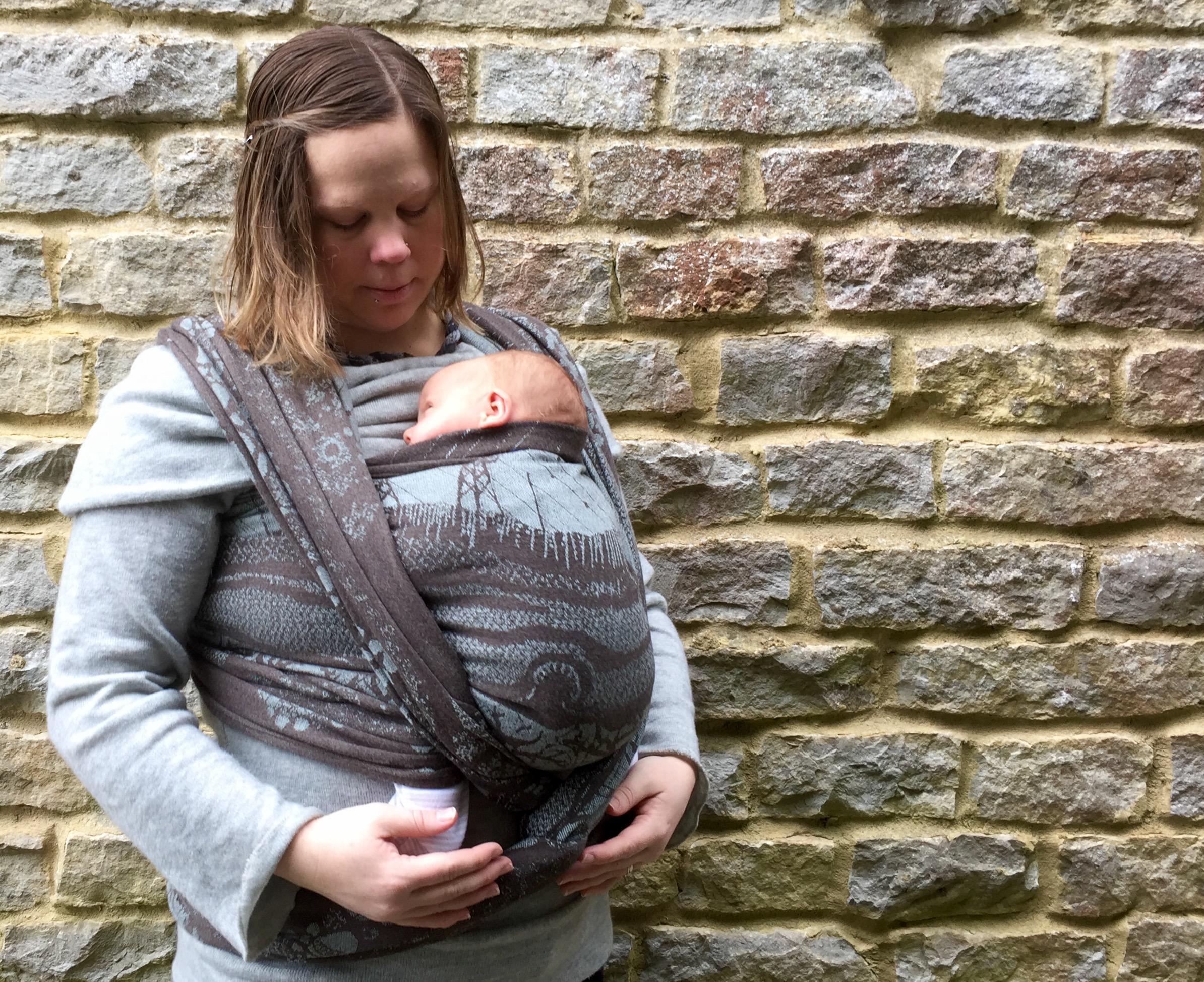 Firespiral Torra Burnish Winter Hill wrapping a newborn