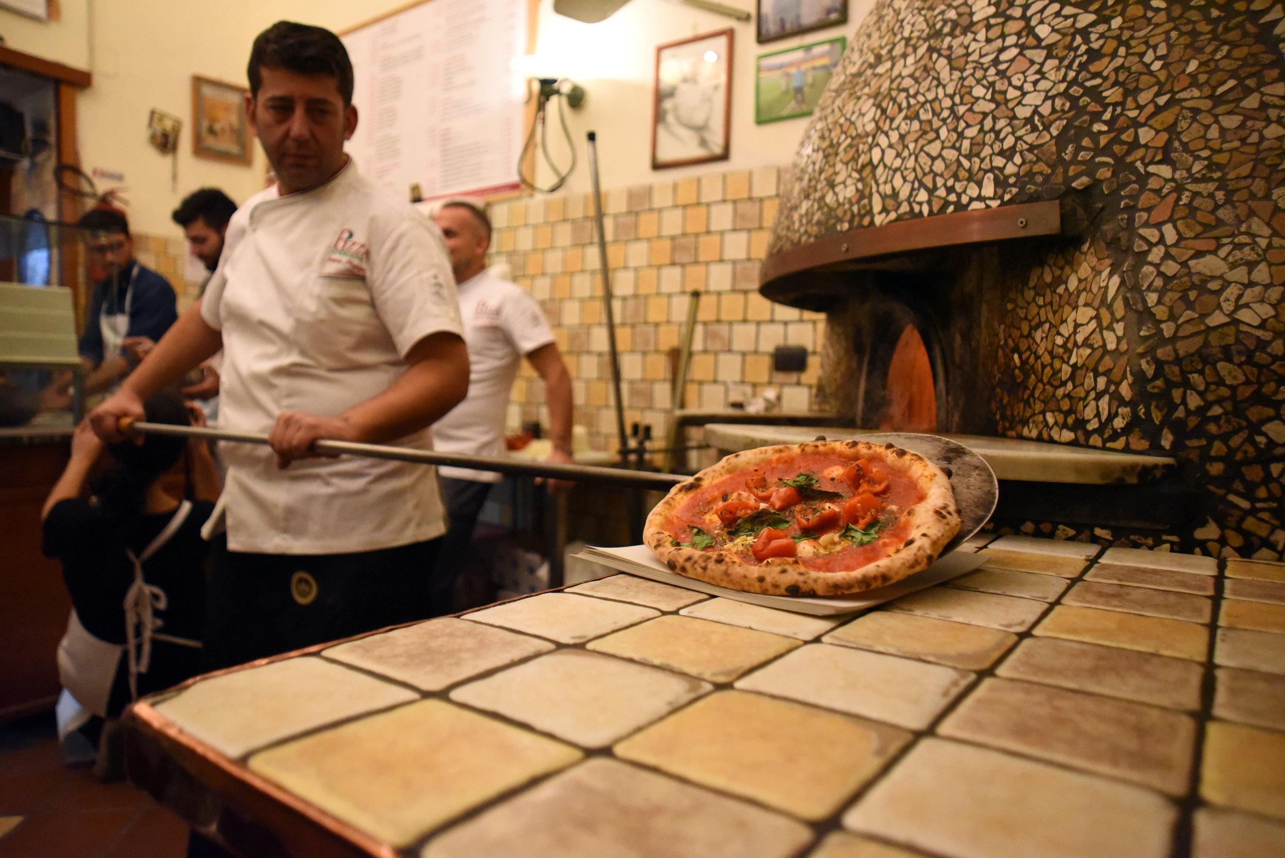 Pizza maker on the job.