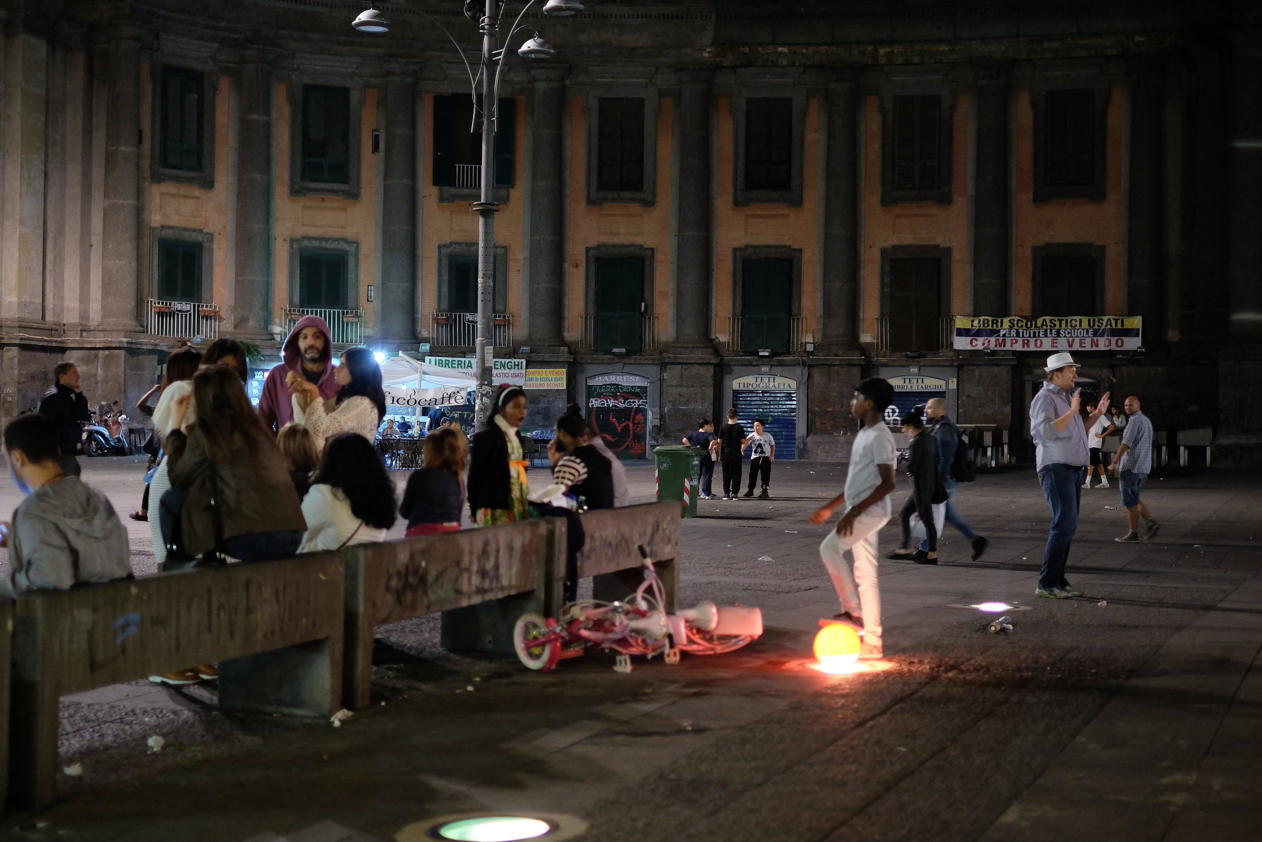 Kids playing football in piazza Dante until late.