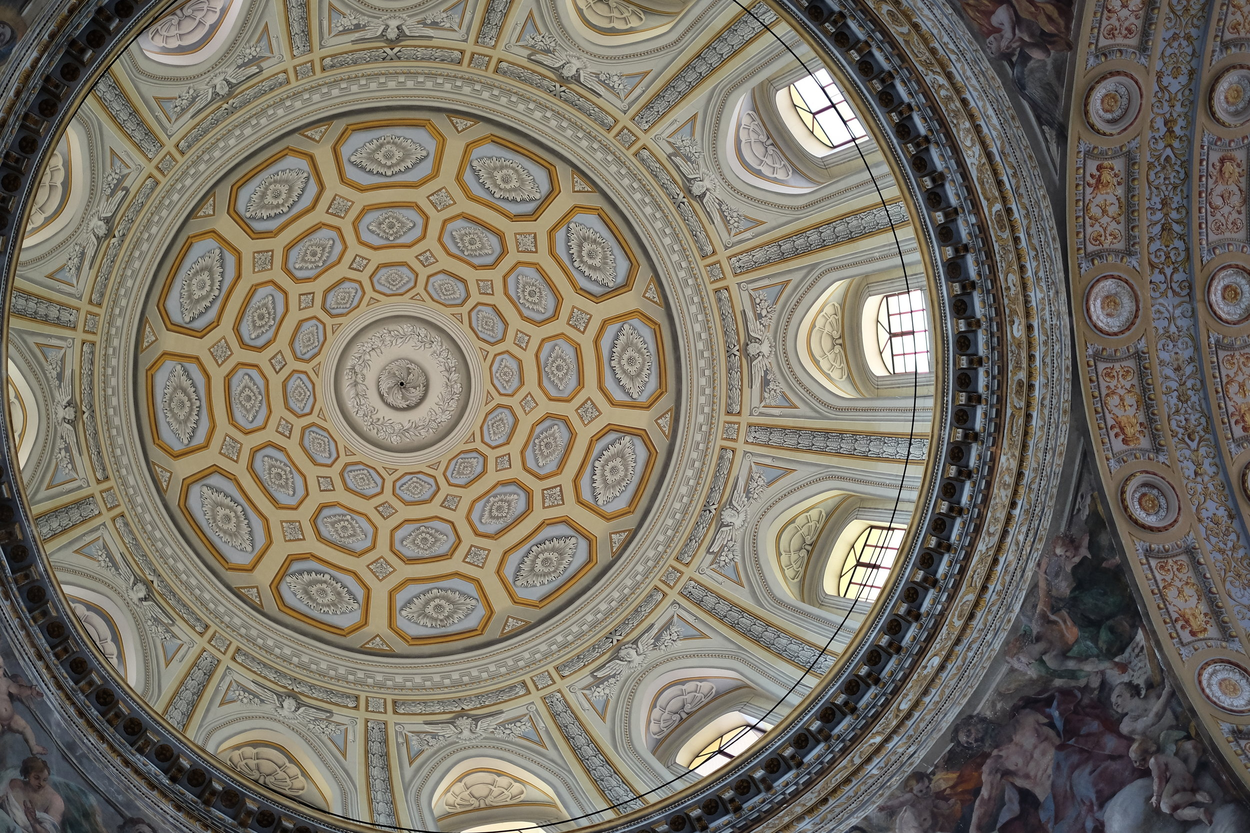 The dome reconstructed after the war, with the frescoes still visible in the corner arches, by Giovanni Lanfranco.