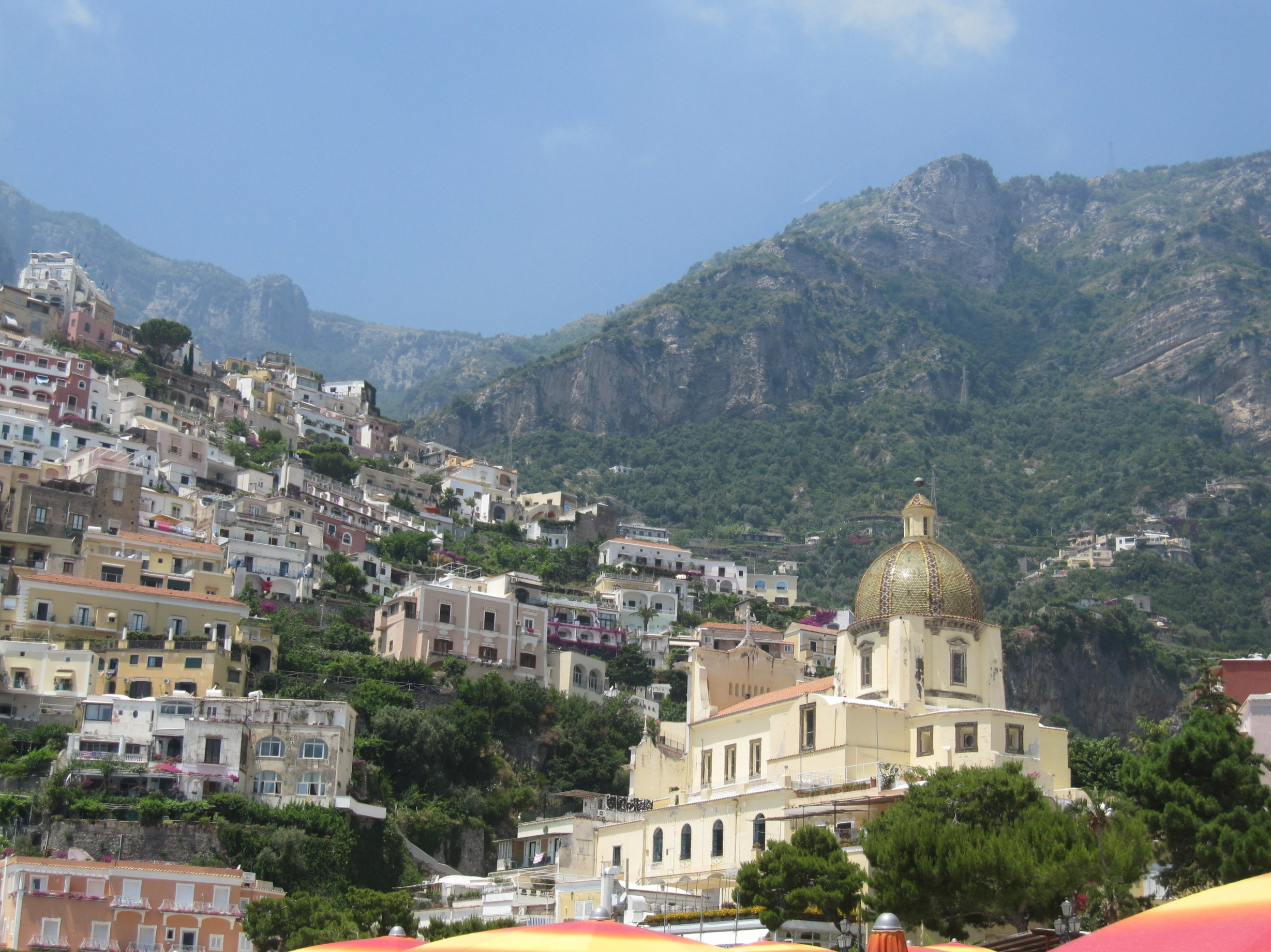 Positano from the beach: the dome of Santa Maria Assunta church.