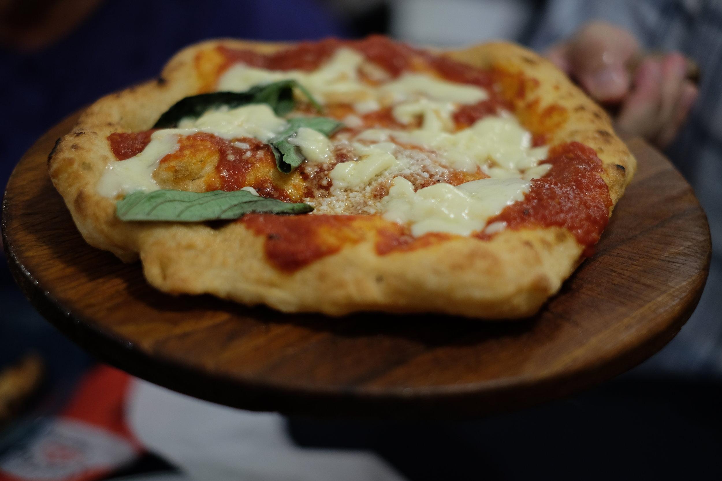 Pizza montanara (pizza fried with tomato sauce, mozzarella an basil) at the pizzeria Starita.