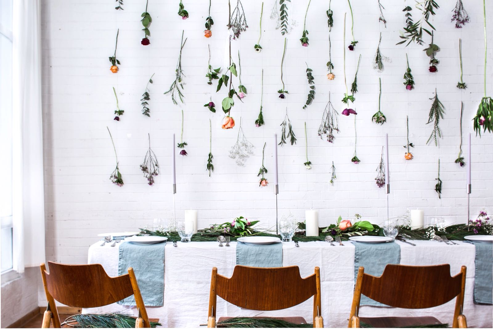 Floral curtain wall hanging and dining setting for an event design project