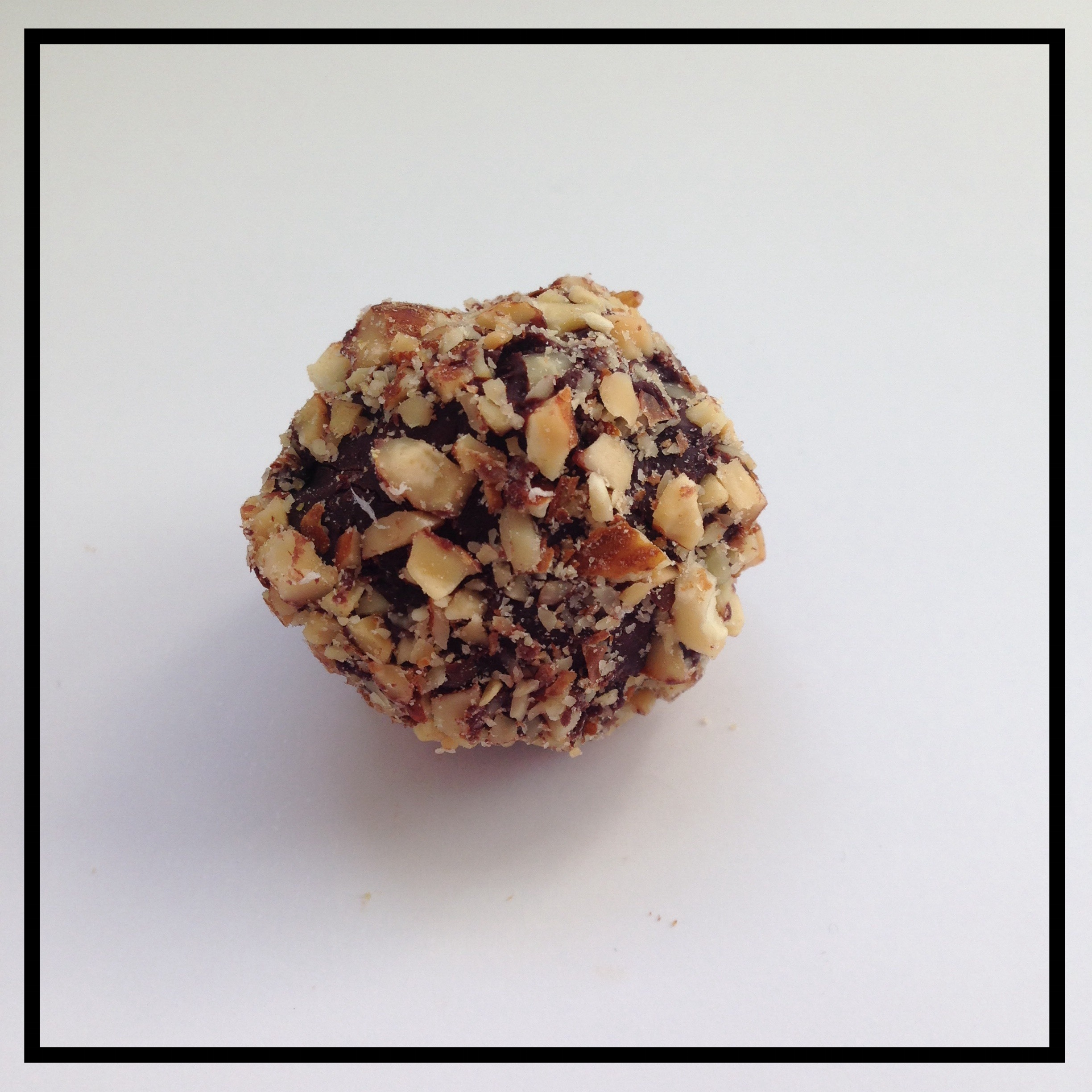 ALMOND   Crushed almonds combined with chocolate ganache, coated in crushed almonds