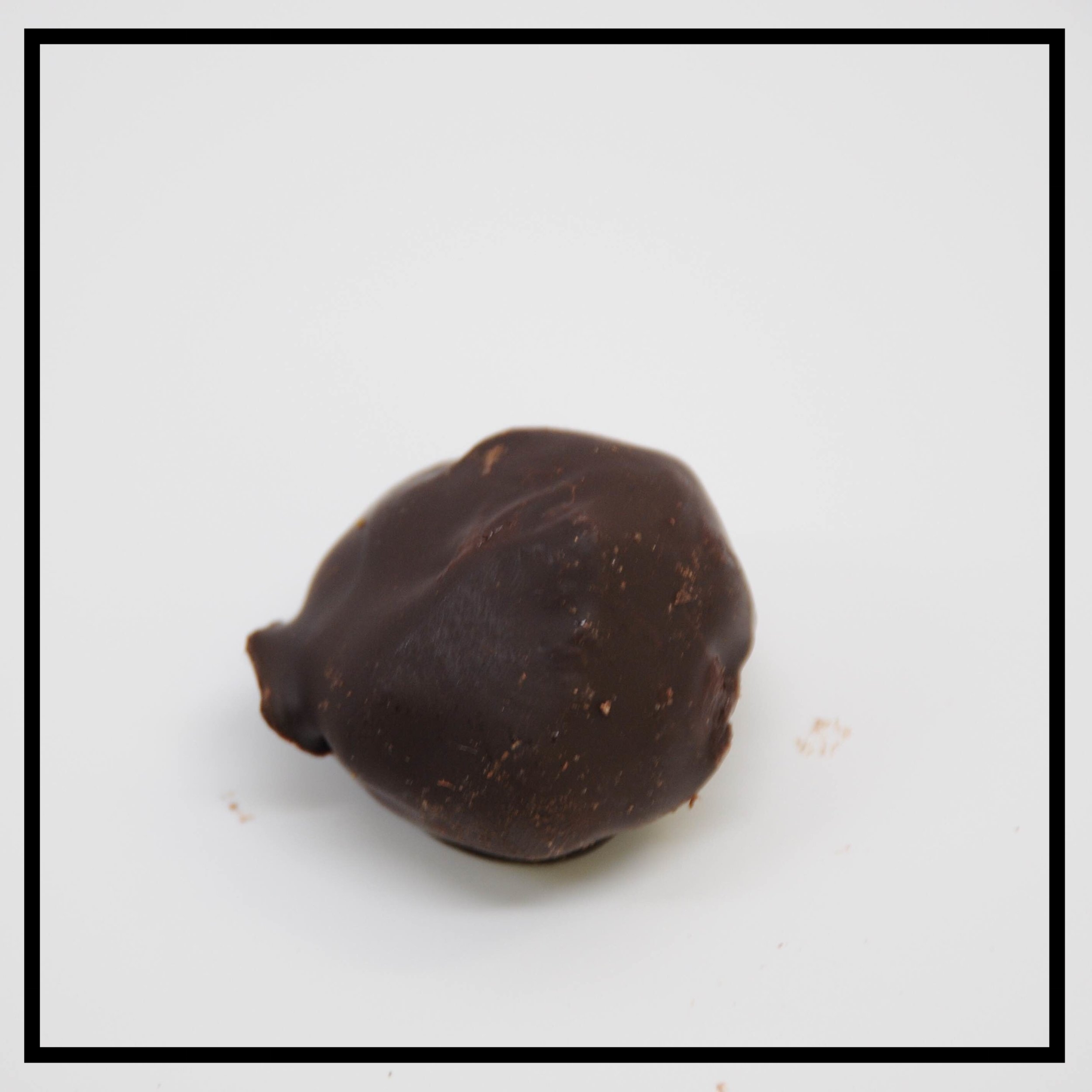 DARK CHOCOLATE   Dark chocolate ganache dipped in dark chocolate, dusted with cocoa