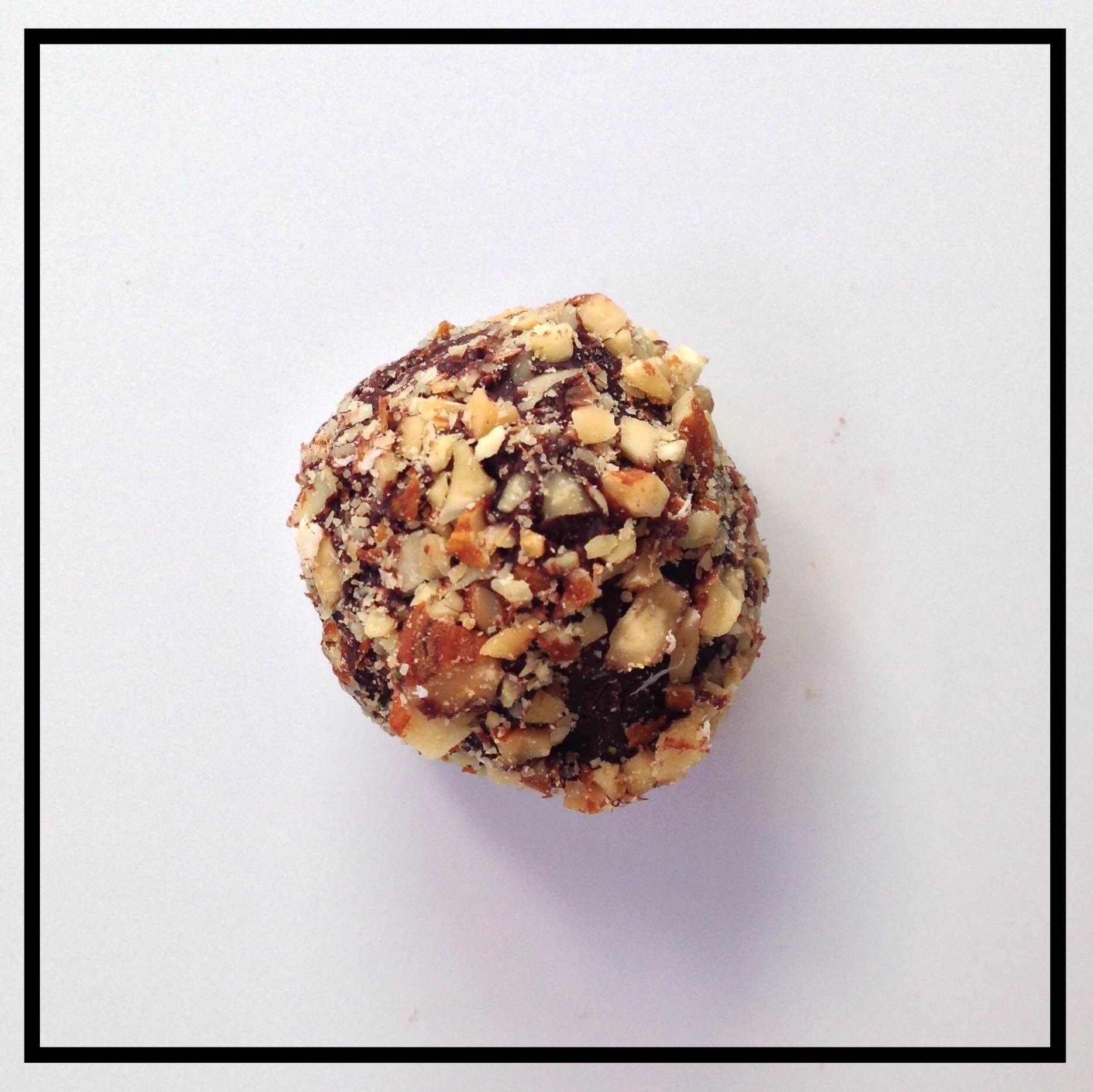 AMARETTO   Amaretto di Saronno blended into chocolate ganache, coated in crushed almonds
